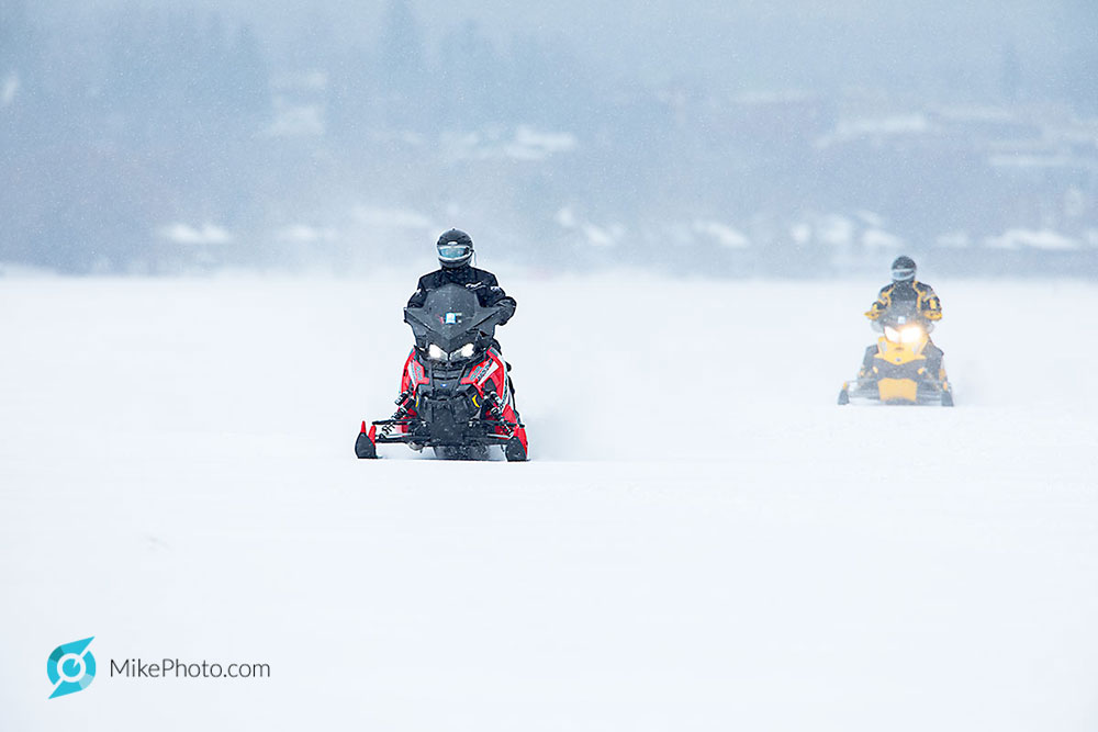 2 snowmobilers at probably 50-60km/h